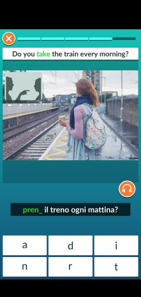 Screenshot of a grammar exercise, showing a picture of a girl waiting to take a train.
