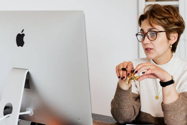 Woman frowns at the Swahili course on her computer screen