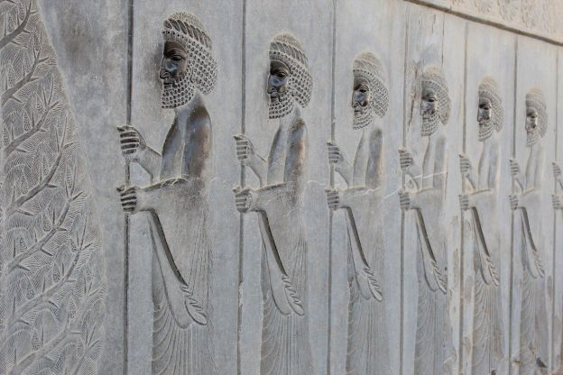 Wall carving of people in procession, from the ancient city of Persepolis, which had been the capital of the Achaemenid Empire.