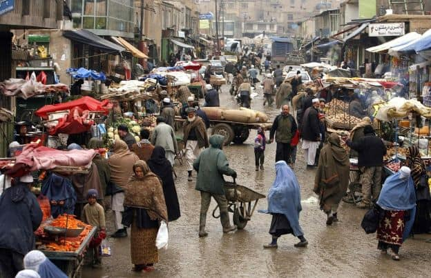 Busy street scene at outdoor Afghan market.