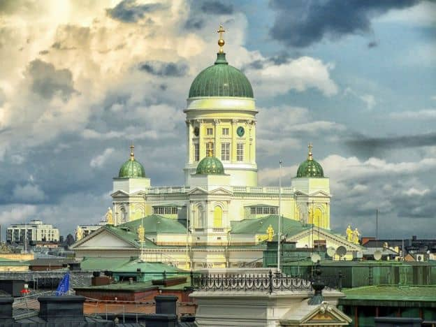 Helsinki Cathedral, with its cream-colored walls and green domes, dominates the skyline in Helsinki.
