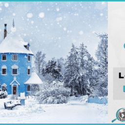 This banner features the blue Moomin House, part of a Finnish amusement park, in a fairytale setting of snow.