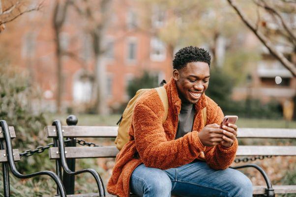 Man smiles while using a language exchange app