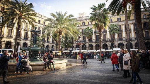 Photo of people in a plaza in Barcelona, Spain.