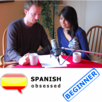 """A picture of the podcast hosts sitting at a table appears over an image of the Spanish flag and the text, """"Spanish Obsessed"""" alongside the word, """"Beginner"""" in blue."""