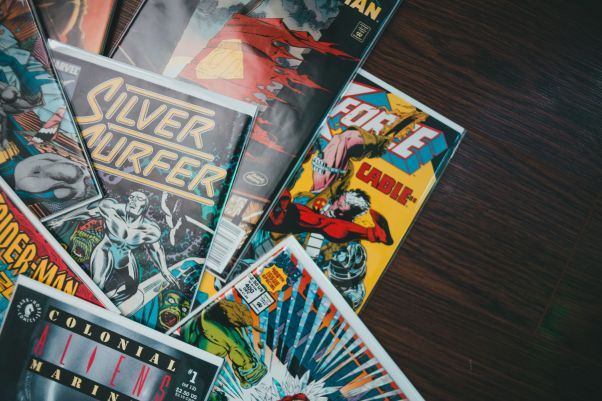Pile of comics on a table