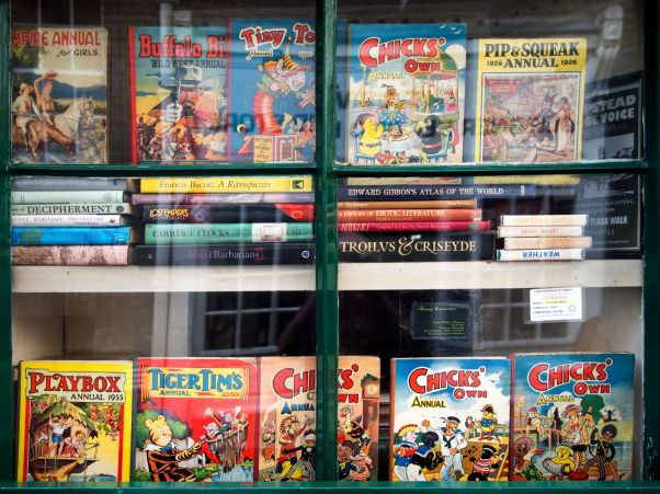 Annuals and comics in the window of a second-hand bookshop